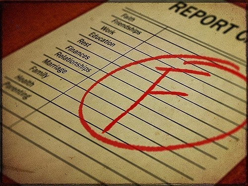 F grade written on a life report card